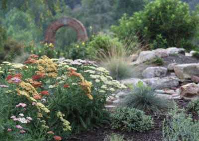 """River Run"" Garden with Brick Arch"